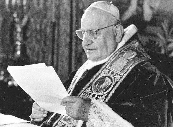 "[Pope John XXIII reads his Easter message, invoking heaven's blessing ""to all men without exception,"" at Vatican City, April 21, 1962. The pontiff, in his fourth Easter message to the world, repeated the words of the risen Christ: ""Peace be to you."" (AP Photo)] *** [] ** Usable by LA and DC Only **"